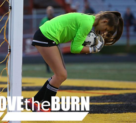 High School Soccer Goalie makes a Save